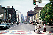 Cityscape urban street view in downtown area thought to be Philadelphia, Pennsylvania, USA in 1976