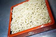 Soba noodles in the kitchen of the Sarashina Horii Restaurant. Tokyo, Japan.