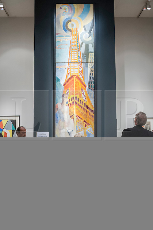 """© Licensed to London News Pictures. 24/06/2015. London, UK.   Visitors look at Robert Delaunay's """"La ville de Paris, la femme et la tour eiffel"""", at the preview of Masterpiece London, the international cross-collecting Fair for art, antiques and design which takes place at The Royal Hospital Chelsea 25 June to 1 July. Photo credit : Stephen Chung/LNP"""