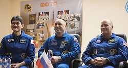 Expedition 54 prime crew members flight engineer Norishige Kanai of Japan Aerospace Exploration Agency (JAXA), left, Soyuz Commander Anton Shkaplerov of Roscosmos, center, and flight engineer Scott Tingle of NASA during a press conference, Saturday, December 16, 2017 at the Cosmonaut Hotel in Baikonur, Kazakhstan. Kanai, Shkaplerov, and Tingle are scheduled to launch to the International Space Station aboard the Soyuz spacecraft from the Baikonur Cosmodrome on December 17. Photo by Joel Kowsky / NASA via CNP/ABACAPRESS.COM