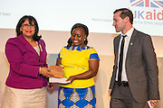 Boston Nyer & Hildah Wanjiku of BURN Manufacturing receiving its award from Baroness Verma of the Department for International Development. The 2015 Ashden Awards ceremony held at the Royal Geographical Society, London. UK.