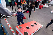 Jakob and Savannah O'Neil play yard games at the AARP Block Party at the Albuquerque International Balloon Fiesta in Albuquerque New Mexico USA on Oct. 7th, 2018.