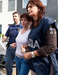 10.06.2011, Questura di Udine, Udine, ITA, Wiener Betonleichen Morde. Italienische Polizeieinheiten haben Freitagfrüh die gesuchte Eissalonbesitzerin Goidsargi Estibaliz C. im Ortszentrum von Udine, Italien, verhaftet. Demnach wurde die 32-Jährige von mobilen Einheiten in der Nähe des Bahnhofs gestellt. Gegen Goidsargi Estibaliz C. bestand nach dem Fund von Teilen zweier einbetonierter Leichen in ihrem Kellerabteil in Wien Meidling ein EU-Haftbefehl. Verdächigt wurde die gebürtige Spanierin, nachdem diese nach der Entdeckung der Leichen anfangs dieser Woche die Flucht ergriffen hatte. Eine der Leichen ist ihr vermisster Ex-Freund Manfred H. Vom zweiten Toten wurde bisher nur der Kopf gefunden, seine Identität ist unklar. Hier im Bild Eissalonbesitzerin Goidsargi Estibaliz C wird von Beamten aus der Questura di Udine geführt. EXPA Pictures © 2011, PhotoCredit: EXPA/ J. Groder