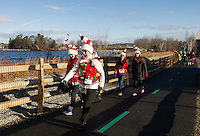 Lindsey Morrissette, Gail Beane, Lisa Morrissette and Audrey Morrissette on Phase II of the Wow Trail during the Santa Shuffle with the Downtown Gym on Sunday morning.  (Karen Bobotas/for the Laconia Daily Sun)
