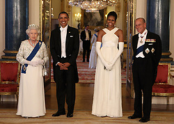 File photo dated 24/05/11 of Queen Elizabeth II and the Duke of Edinburgh posing with U.S. President Barack Obama and First Lady Michelle Obama in the Music Room of Buckingham Palace ahead of a State Banquet, as part of the Presidents three-day state visit to the UK. Prince Philip's final public engagement takes place on Wednesday, before he retires at the age of 96.