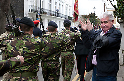 © licensed to London News Pictures. London, UK 10/03/2012. A man clapping as London's Territorial Army soldiers, many of whom have taken part in overseas operations in Iraq and Afghanistan marching on Kensington High Street this noon (10/03/12). Photo credit: Tolga Akmen/LNP