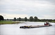 Nederland, Cuijk, 9-10-2013Een binnenvaartschip geladen met grint vaart over de Maas richting Rotterdam.Foto: Flip Franssen/Hollandse Hoogte