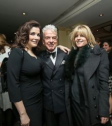 © Licensed to London News Pictures. 09/12/2014.LONDON UK. Nigella Lawson, Nicky Haslam, Rachel Johnson.<br /> <br /> Media Society Annual Dinner 2014. Alan Yentob, Creative Director of the BBC, received the Media Society award honouring his diverse career in broadcasting at the Society's annual dinner, held at the Millennium Hotel Mayfair, London. Photo credit : ANDREW BAKER/LNP