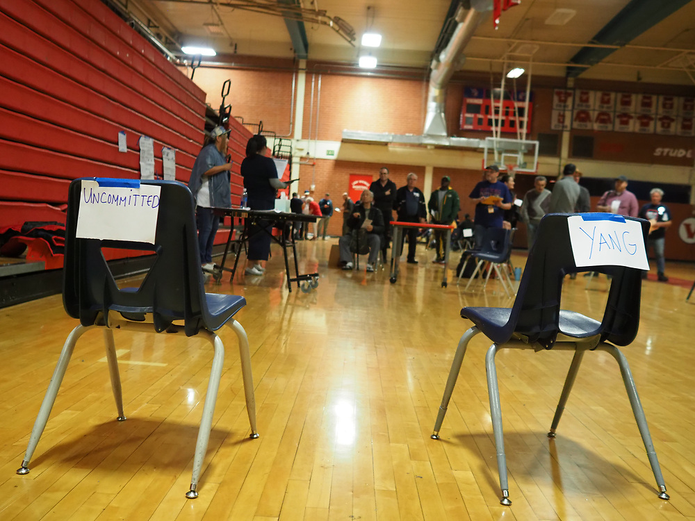 In the first round of voting, called the alignment, the chairs for uncommitted and Yang are empty.