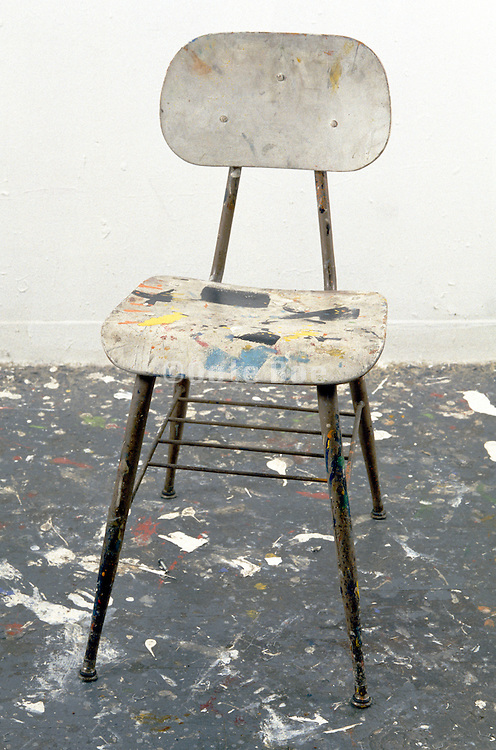 studio chair covered in paint