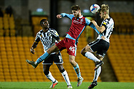 John McAtee (45) of Scunthorpe United Nathan Smith (6) of Port Vale battles for possession during the EFL Sky Bet League 2 match between Port Vale and Scunthorpe United at Vale Park, Burslem, England on 17 November 2020.