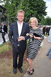 MARIELLA FROSTRUP and her husband JASON McCUE at the annual Serpentine Gallery Summer Party sponsored by Canvas TV  the new global arts TV network, held at the Serpentine Gallery, Kensington Gardens, London on 9th July 2009.