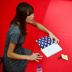 Image ©Licensed to i-Images Picture Agency. 12/08/2014. London, United Kingdom. Alexa Chung, model, TV presenter and style icon signs copies of her bestselling book, 'IT' which combines her writing with personal drawings, sketches and photographs. Picture by Nils Jorgensen / i-Images