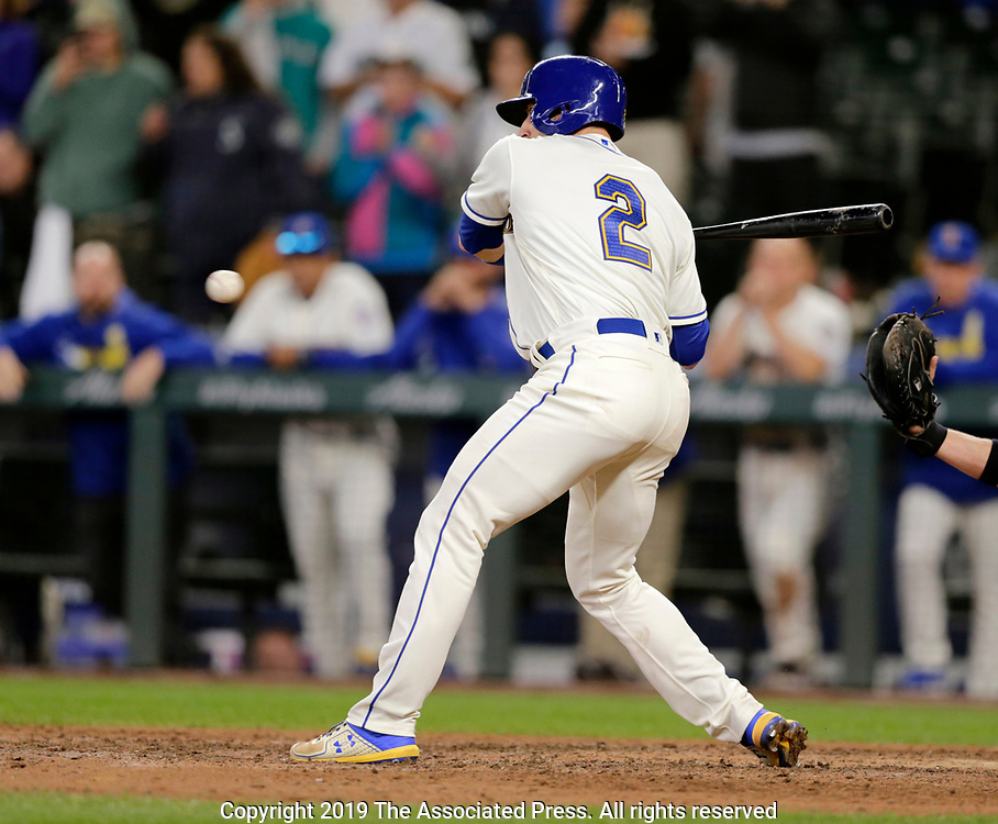 Seattle Mariners' Tom Murphy washes ball four for a bases loaded walk from Chicago White Sox relief pitcher Jose Ruiz in the bottom of the ninth inning to win 11-10 in a baseball game, Sunday, Sept. 15, 2019, in Seattle. (AP Photo/John Froschauer)