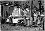 Weaving shed fitted with Jacquard power looms.   Swags of punched cards carrying pattern being woven are at right and above each loom.  Illustration Paris c1880
