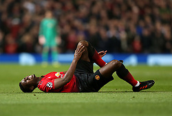 Manchester United's Paul Pogba lies injured