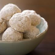 Elegant Italian Wedding Cookies in blue bowl