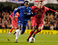 Photo: Leigh Quinnell.<br /> Chelsea v Liverpool. UEFA Champions League. <br /> 06/12/2005.Chelseas Michael Essien can't break away from Liverpools  Dietmar Hamann.
