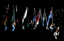 Athletes carry their nations flags during the Closing Ceremony for the 2018 Commonwealth Games at the Carrara Stadium in the Gold Coast, Australia. PRESS ASSOCIATION Photo. Picture date: Sunday April 15, 2018. See PA story COMMONWEALTH Ceremony. Photo credit should read: Danny Lawson/PA Wire. RESTRICTIONS: Editorial use only. No commercial use. No video emulation.