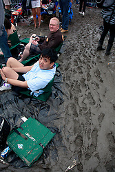 03 May 2013. New Orleans, Louisiana,  USA. .New Orleans Jazz and Heritage Festival. .JazzFest turns into a mud-fest following the recent heavy rains and flooding in the region. .Photo; Charlie Varley.