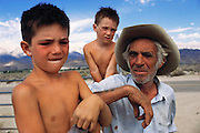 Gene Churchill, rancher near Lone Pine Station, California (photographed with his sons, Travis, 6, and Grant,4 and his horse, Ringo). He was raising his two sons alone since his wife was arrested 18 months earlier for drugs and prostitution. Route 395: Eastern Sierra Nevada Mountains of California. MODEL RELEASED.