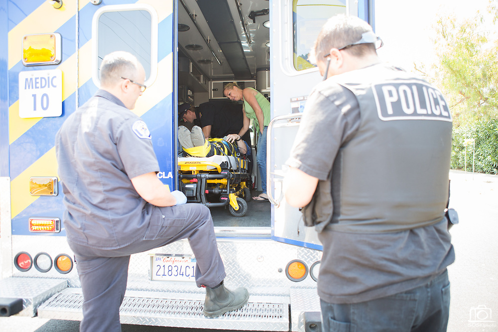 Amanda Wallters of Milpitas briefly talks with her son, Jeffrey Prachick, 17, in an ambulance after crashing his Dodge Durango SUV during an alleged speed contest with another car near Jacklin Road and Evans Road in Milpitas, California, on June 6, 2013. (Stan Olszewski/SOSKIphoto)