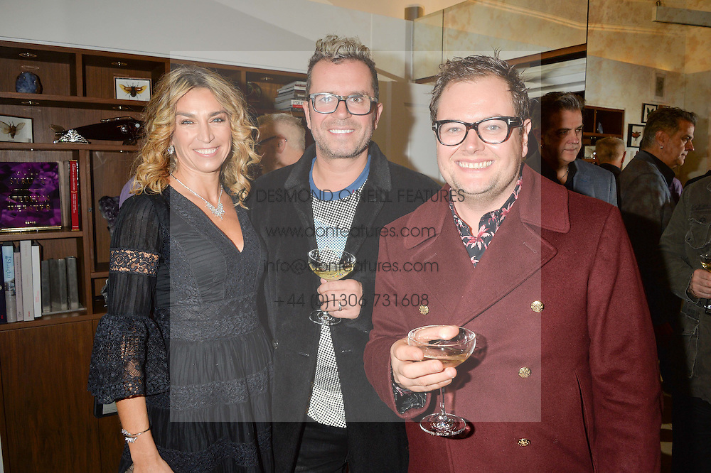 Left to right, ASSIA WEBSTER, PAUL DRAYTON and ALAN CARR at a private view of Stephen Webster's new White Kite collection held at his flagship store at 130 Mount Street, London on 24th November 2016.