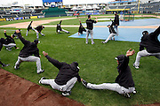 Chicago White Sox players stretch before a baseball game against the Kansas City Royals at Kauffman Stadium in Kansas City, Mo., Saturday, May 4, 2013.  (AP Photo/Colin E. Braley).