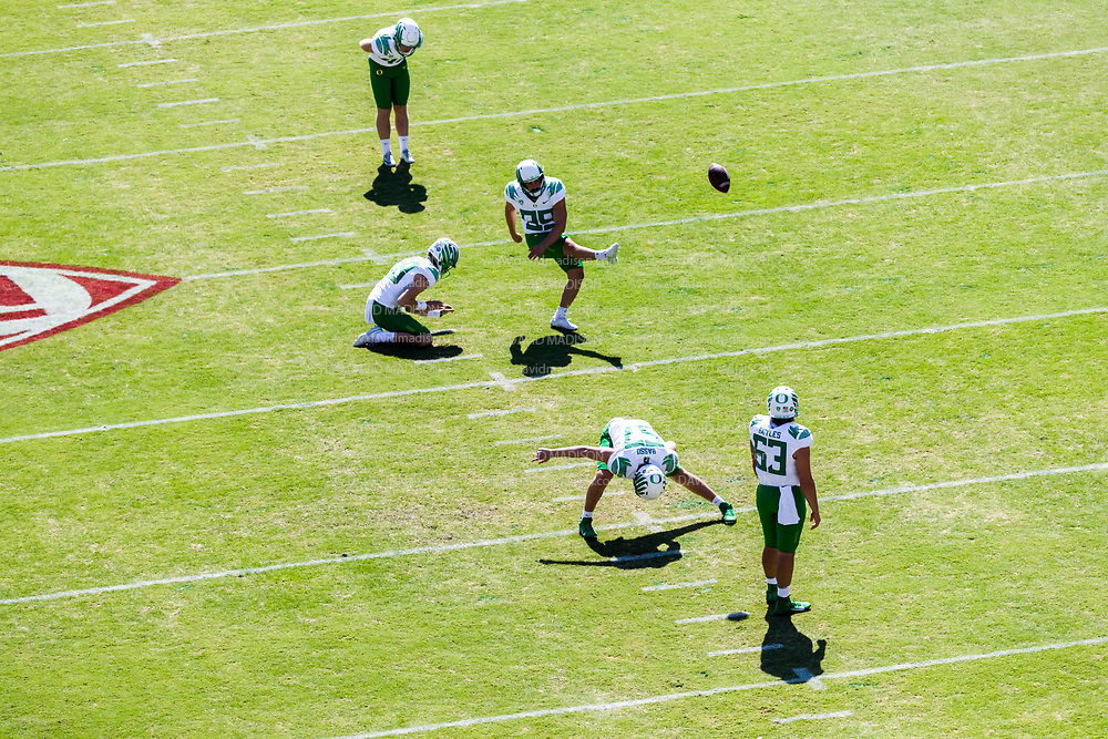 PALO ALTO, CA - OCTOBER 2:  Kicker Henry Katleman #99 of the Oregon Ducks and teammates including T.J. Basso #57 and Karsten Battles #63 warm up before a Pac-12 football game against the Stanford Cardinal on October 2, 2021 at Stanford Stadium in Palo Alto, California.  (Photo by David Madison/Getty Images)