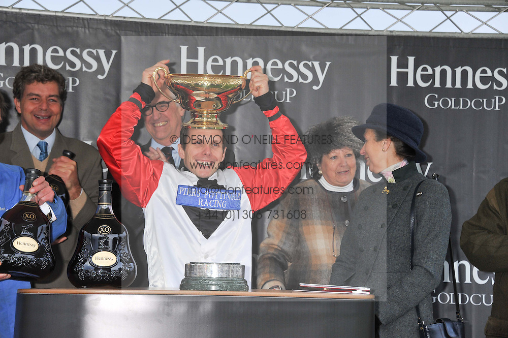 Jockey of Carruthers the 2011 Hennessy Gold Cup winner MATTIE BATCHELOR with the Hennessy Gold cup watched by HRH the PRINCESS ROYAL at the Hennessy Gold Cup at Newbury Racecourse, Berkshire on 26th November 2011.