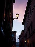 Street scene at night, Rome, Italy