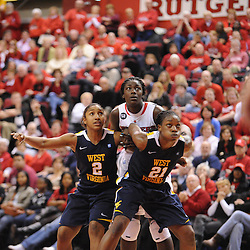 West Virginia Mountaineers guard Taylor Palmer (2) and guard/forward Korinne Campbell (21) guard Rutgers Scarlet Knights forward Chelsey Lee (52) on a free throw play during second half Big East NCAA women's basketball action during Rutgers' 67-58 victory over West Virginia at the Louis Brown Rutgers Athletic Center.