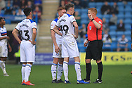 Joe Bunney is lectured by the referee during the EFL Sky Bet League 1 match between Gillingham and Rochdale at the MEMS Priestfield Stadium, Gillingham, England on 30 March 2019.