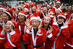 Members of the Laughter Yoga club participate in an event called Christmas Smile near the Hoan Kiem Lake in Hanoi, Vietnam, December 23, 2012. Photo by Imago / i-Images...UK ONLY