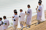 """05 FEBRUARY 2013 - PHNOM PENH, CAMBODIA:  Brahmin priests from the Royal Court board the barge that will carry King-Father Norodom Sihanouk's ashes up the Mekong River. Sihanouk's ashes will be scattered in locations across Cambodia. Tuesday, they were scattered on the Mekong River. Norodom Sihanouk (31 October 1922- 15 October 2012) was the King of Cambodia from 1941 to 1955 and again from 1993 to 2004. He was the effective ruler of Cambodia from 1953 to 1970. After his second abdication in 2004, he was given the honorific of """"The King-Father of Cambodia."""" Sihanouk died in Beijing, China, where he was receiving medical care, on Oct. 15, 2012.   PHOTO BY JACK KURTZ"""