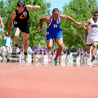 051014       Adron Gardner<br /> <br /> Clayton Yellowjacket Koy Geary, left, dives across the finish line in first place past Laguna Acoma Hawk David McGee, center, in second place during the AA boys 100m dash at  the New Mexico State Track meet at the New Mexico State Track meet at the University of New Mexico in Albuquerque Saturday.