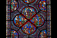 Medieval Windows  of the Gothic Cathedral of Chartres, France, dedicated to the life an miracles of St Nicholas. A UNESCO World Heritage Site. Bottom corner shows During a famine, Nicholas persuades sailors to give the town some grain, bottom left shows The sailors bringing grain ashore . Centre panel bottom, The young St Nicholas does well at school, left Nicholas secretly gives gold to an old man to save his daughters , right The old man tries to thank Nicholas, who humbly flees from him, top .Nicholas is chosen to be the new Bishop of Myra.  . .<br /> <br /> Visit our MEDIEVAL ART PHOTO COLLECTIONS for more   photos  to download or buy as prints https://funkystock.photoshelter.com/gallery-collection/Medieval-Middle-Ages-Art-Artefacts-Antiquities-Pictures-Images-of/C0000YpKXiAHnG2k