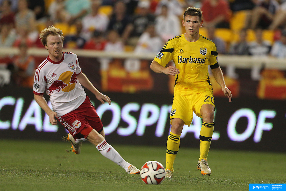 Wil Trapp, (right), Columbus Crew, in action during the New York Red Bulls Vs Columbus Crew, Major League Soccer regular season match at Red Bull Arena, Harrison, New Jersey. USA. 12th July 2014. Photo Tim Clayton