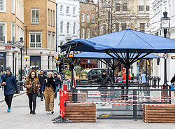 © Licensed to London News Pictures. 07/04/2021. London, UK. With less than 5 days before the great unlock-down, workmen are in full swing preparing outdoor seating and heating to restaurants in Covent Garden, London. This week Prime Minister, Boris Johnson announced that pubs, shops, gyms and hairdressers will be allowed to open to the public from this Monday, 12th April 2021 as England takes its first big steps out of the coronavirus pandemic restrictions. Photo credit: Alex Lentati/LNP