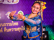 """24 JULY 2014 - BANGKOK, THAILAND: A traditional dancer performs at the happiness party in Bangkok. The Thai Junta is organizing a series of public events throughout Thailand meant to bolster public opinion. The events are called """"restoring happiness to the people"""" parties. They feature historic pageants, music, food, health checks and free haircuts. The party in Bangkok is on Sanam Luang, the Royal Parade Ground, which is near the Grand Palace and the Ministry of Defense.    PHOTO BY JACK KURTZ"""