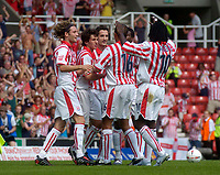 Photo. Glyn Thomas.Digitalsport<br /> Stoke City v Wolverhampton Wanderers. <br /> Coca Cola Championship. 08/08/2004.<br /> Stoke's Clive Clarke (C) celebrates with teammates after scoring from the penalty spot to put his side two goals in front.