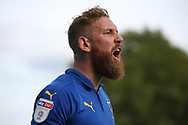 AFC Wimbledon midfielder Scott Wagstaff (7) shouting during the EFL Sky Bet League 1 match between AFC Wimbledon and Scunthorpe United at the Cherry Red Records Stadium, Kingston, England on 15 September 2018.