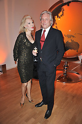 DONATELLA FLICK and JONATHAN MERMAGEN at the TOD'S Art Plus Drama Party at the Whitechapel Gallery, London on 24th March 2011.