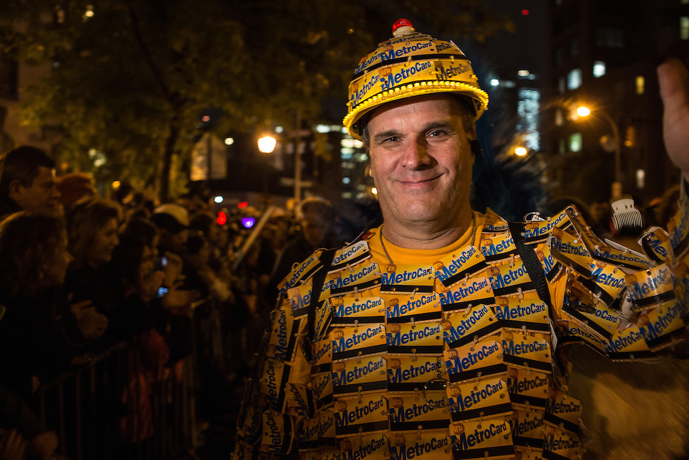 New York, NY, October 31, 2013. A man wearing a costume composed of New York's Metropolitan Transit Authority's Metrocards in New York's Greenwich Village Halloween Parade.