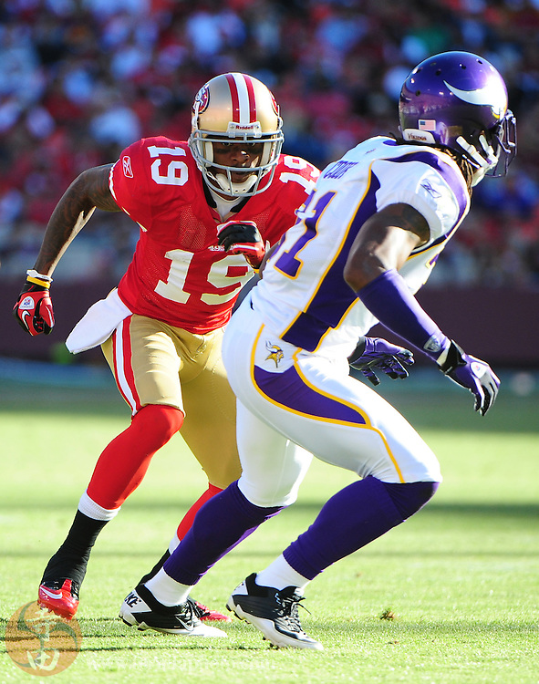 August 22, 2010; San Francisco, CA, USA; San Francisco 49ers wide receiver Ted Ginn Jr. (19) runs a route in front of Minnesota Vikings cornerback Chris Cook (31) during the second quarter at Candlestick Park. Mandatory Credit: Kyle Terada-Terada Photo