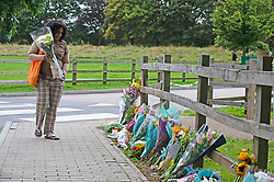 © Licensed to London News Pictures 23/09/2021. Kidbrooke, UK, A local resident arriving with some flowers for Sabina. A large police cordon is still in place around Cator Park at Kidbrooke Village in Kidbrooke, South East London today after the body of 28 year old school teacher Sabina Nessa was found near a community centre. Police have said Sabina left her home and walked through Cator Park heading for the Depot pub at Pegler Square in Kidbrooke Village to meet a friend. Photo credit:Grant Falvey/LNP