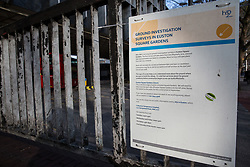 London, UK. 13th January, 20187. A notice indicating ground investigation surveys in Euston Square Gardens outside Euston station. Many mature London Plane, Red Oak, Common Lime, Common Whitebeam and Wild Service trees in Euston Square Gardens are expected to be felled to make way for temporary sites for construction vehicles and a displaced taxi rank as part of preparations for the HS2 rail line.