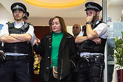 London, UK. 1 June, 2019. Betty Ferro, who is responsible for outsourced cleaners working at the DoubleTree Hilton Hotel, comes to the entrance of the hotel to speak to Dalia Quinonez Guerrero, a former cleaner at the hotel from whom wages were withheld. Members of United Voices of the World (UVW), a grassroots trade union representing mainly migrant workers, supported by the Independent Workers of Great Britain (IWGB), were protesting at the hotel in solidarity with the former cleaner.