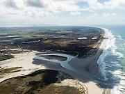 Nederland, Noord-Holland, Texel, 16-04-2012; De Slufter, gezien in zuidelijke richting, rechts de Noordzee. Het Marsdiep met de zandplaat Noorderhaaks aan de horizon..Het natuurgebied, een duinvalllei met kreken, is ontstaan doordat de duinen in het verleden doorgebroken zijn. De Sluftervallei staat in open verbinding met de Noordzee en wordt beïnvloed door eb en vloed.  .View on  natural area The Slufter, beach and dunes of the isle of Texel. Northsea on the right...luchtfoto (toeslag), aerial photo (additional fee required);.copyright foto/photo Siebe Swart