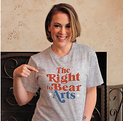 """Alyssa Milano releases a photo on Instagram with the following caption: """"First we group hug, then we get back to work and make an impact. Arts in the classroom, community and our country is a necessary right that\u2019s for the betterment of everyone. Get informed and join me in showing your support for the arts with this t-shirt. Get yours at omaze.com/arts. \nEvery shirt supports the amazing work of @thecreativecoalition, so let\u2019s make the world a better place."""". Photo Credit: Instagram *** No USA Distribution *** For Editorial Use Only *** Not to be Published in Books or Photo Books ***  Please note: Fees charged by the agency are for the agency's services only, and do not, nor are they intended to, convey to the user any ownership of Copyright or License in the material. The agency does not claim any ownership including but not limited to Copyright or License in the attached material. By publishing this material you expressly agree to indemnify and to hold the agency and its directors, shareholders and employees harmless from any loss, claims, damages, demands, expenses (including legal fees), or any causes of action or allegation against the agency arising out of or connected in any way with publication of the material."""